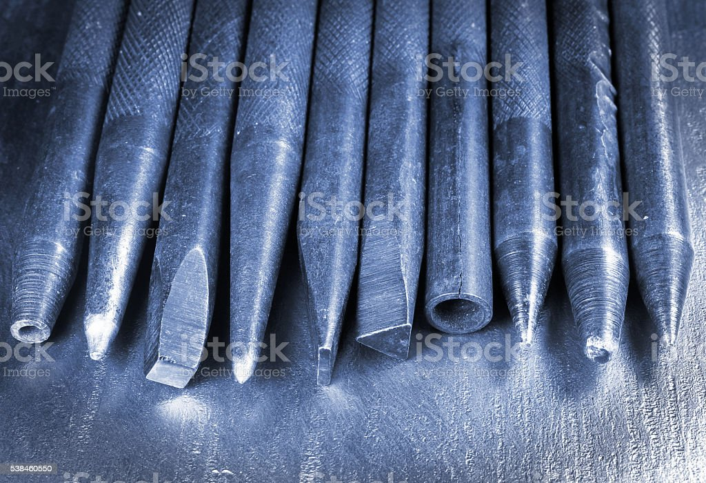 Old hand iron punchers and chisels stock photo