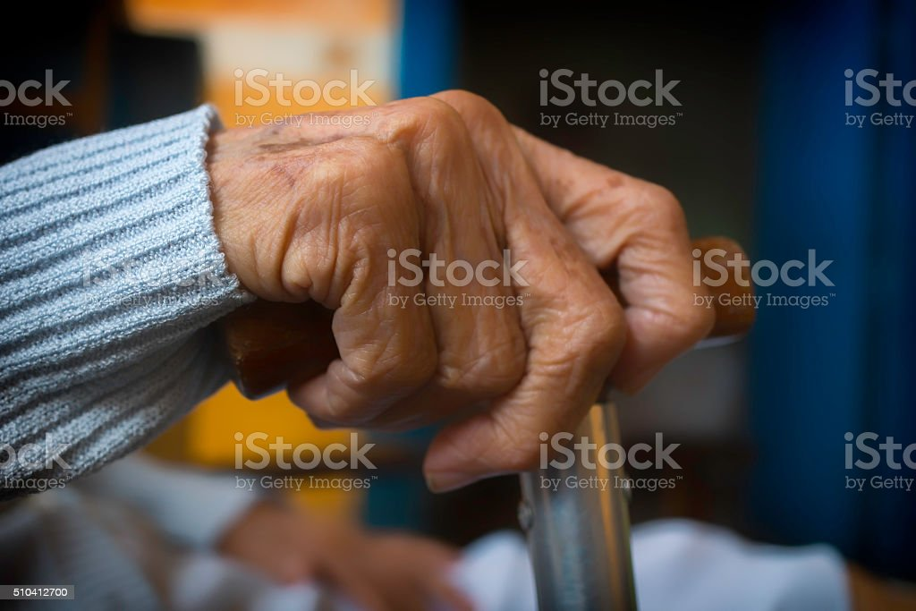 Old Hand With Walking Stick stock photo