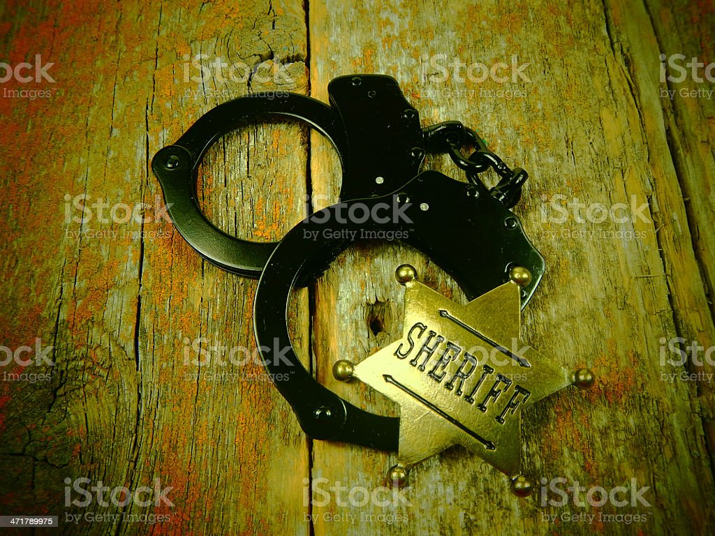 Old Handcuff and Badge Photo royalty-free stock photo