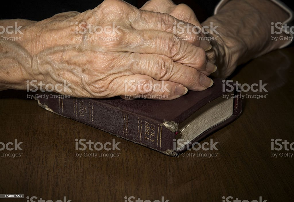 old hands and Book of faith royalty-free stock photo