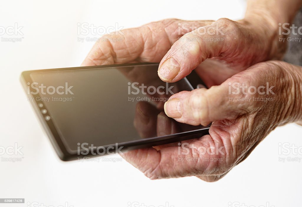 old hands, cellphone, technology, contrasts,using phone, copy space stock photo