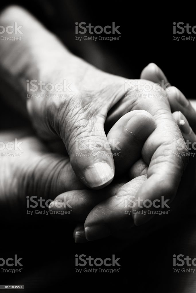 Old Hands Grasping Each Other royalty-free stock photo