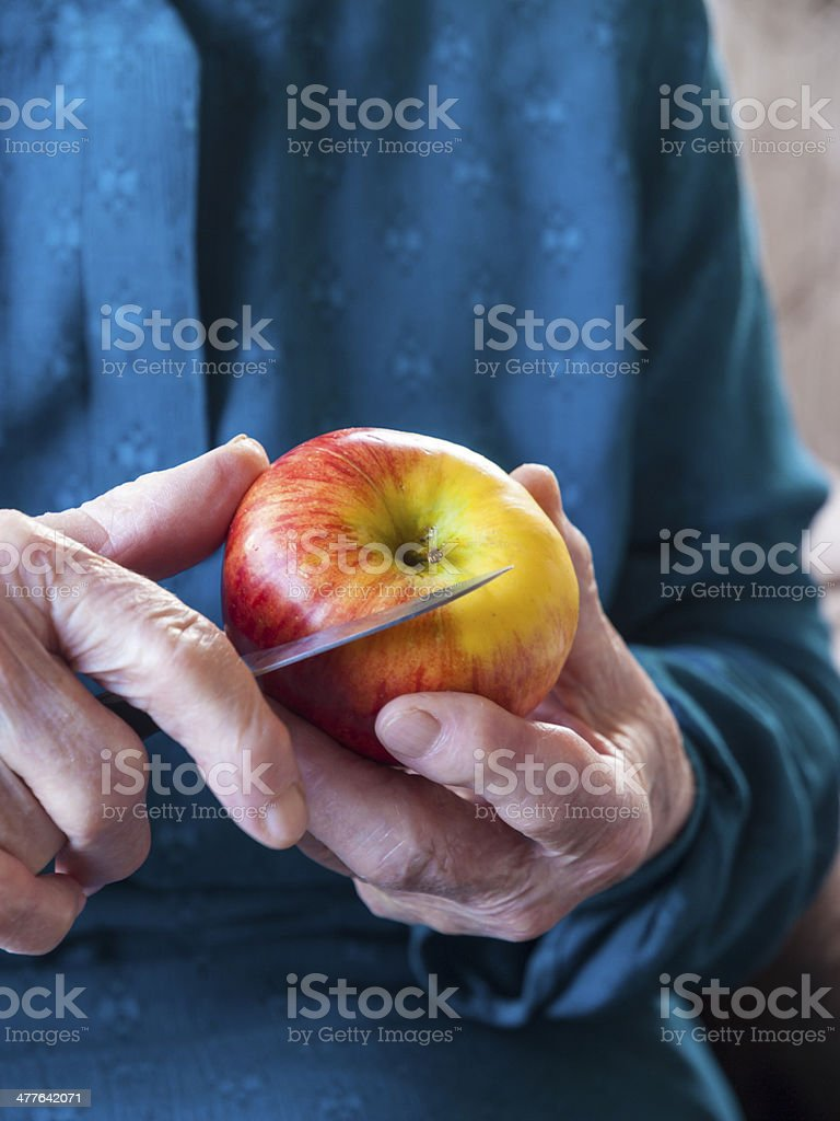 Old hands holding an apple royalty-free stock photo