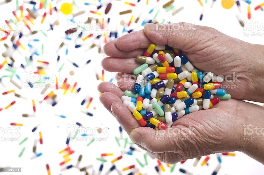 Old hands holding capsules royalty-free stock photo