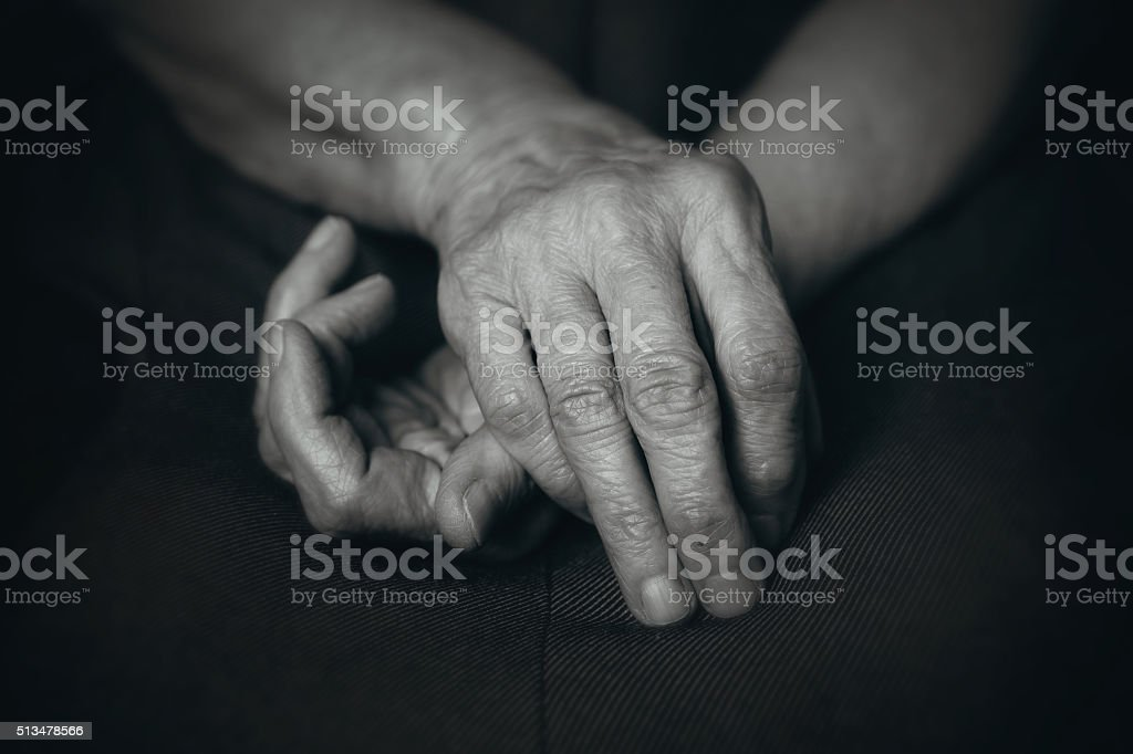 Old hands of elderly man stock photo