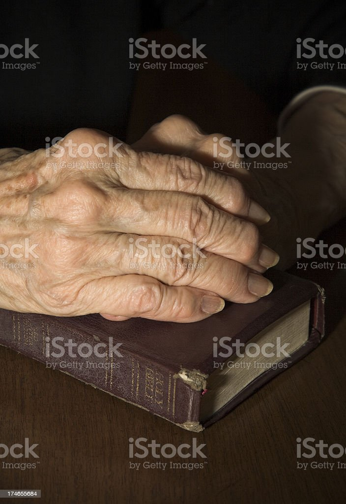 old hands on Book of faith royalty-free stock photo