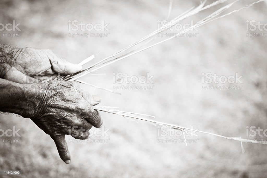 Old Hands Weaving Straw Rope royalty-free stock photo