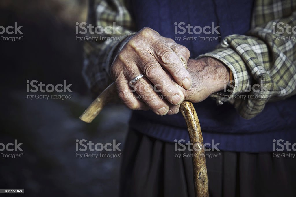 Old hands with walking stick royalty-free stock photo