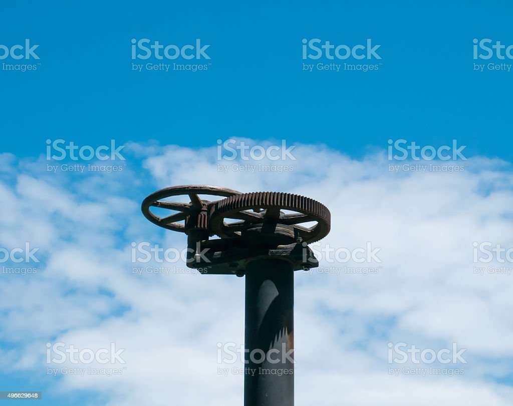 old handwheel of valve in a sky background stock photo