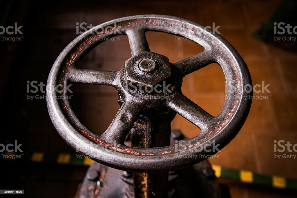 old handwheel of valve stock photo