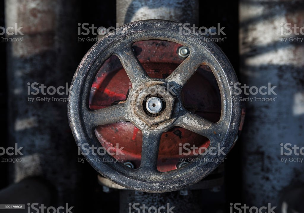 old handwheel of valve. top view stock photo