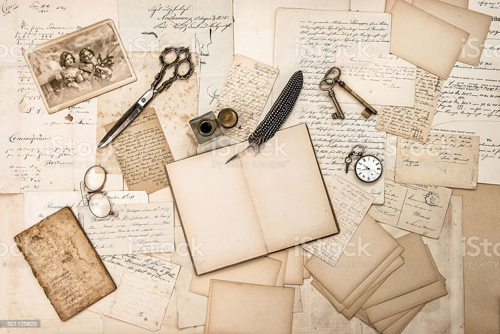 Old handwritten letters, pictures and antique writing accessories stock photo