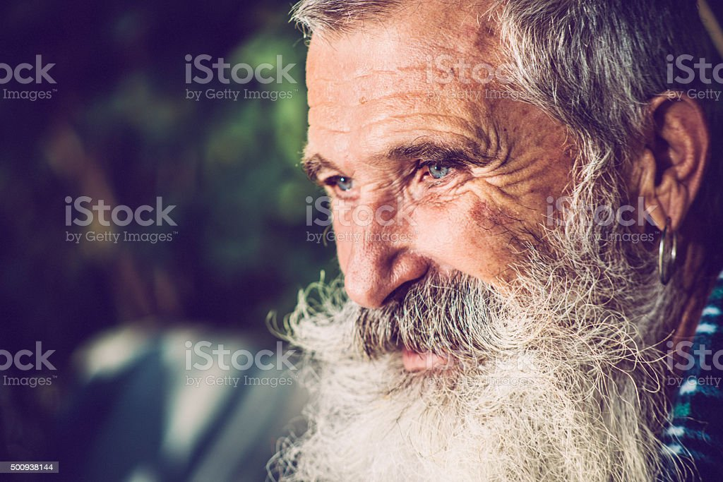 Old Happy Man with Extremely Long Beard Outdoors, Close-up stock photo