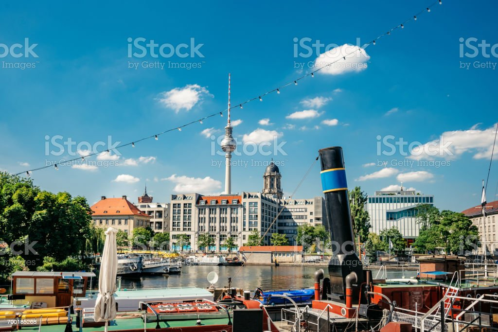 old harbor with boats at Fischerinsel in Berlin and TV-Tower stock photo