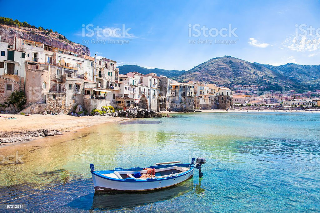 Old harbor with wooden fishing boat in Cefalu, Sicily stock photo