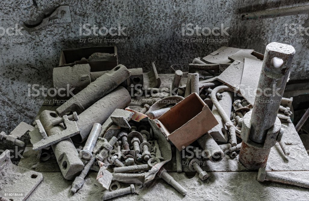 Old hardware covered with a thick layer of dust in an abandoned factory stock photo