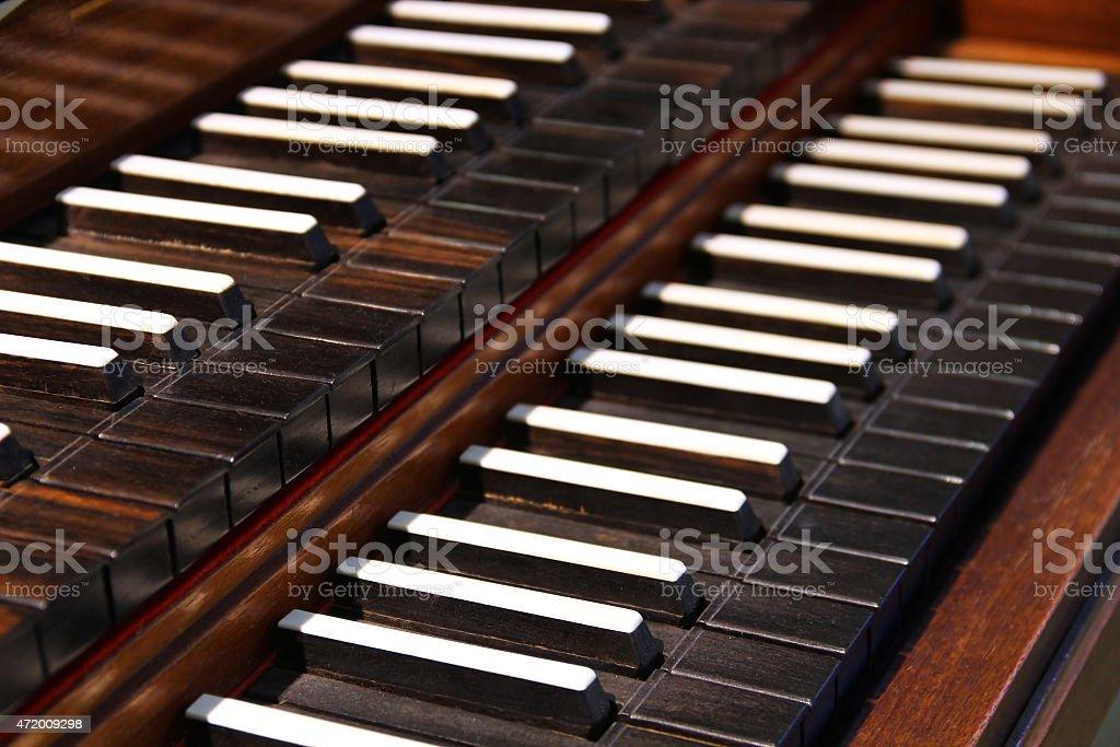 Old harpsichord keys stock photo