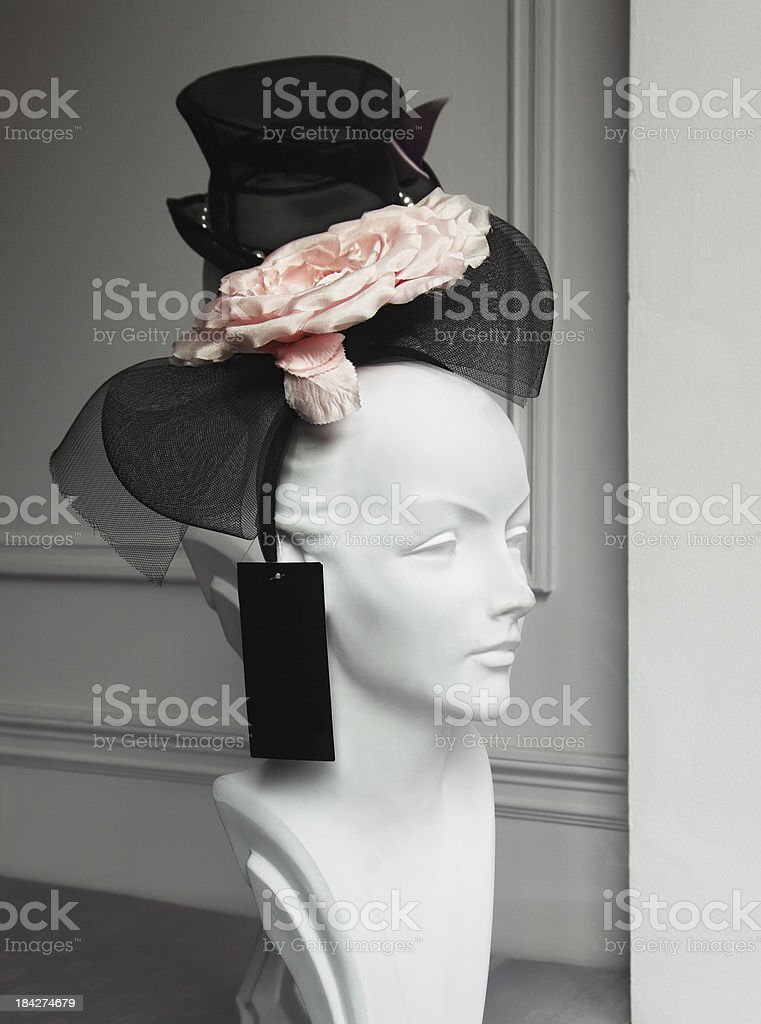 Old hat on a mannequin head in an antique shop royalty-free stock photo