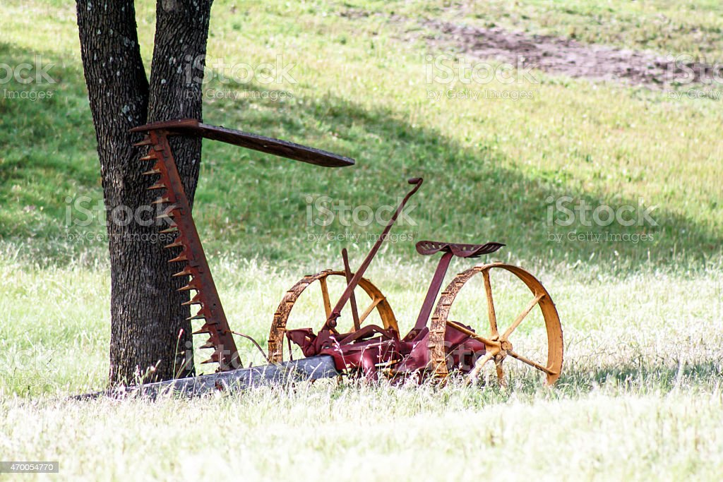 old hay mower and plow stock photo