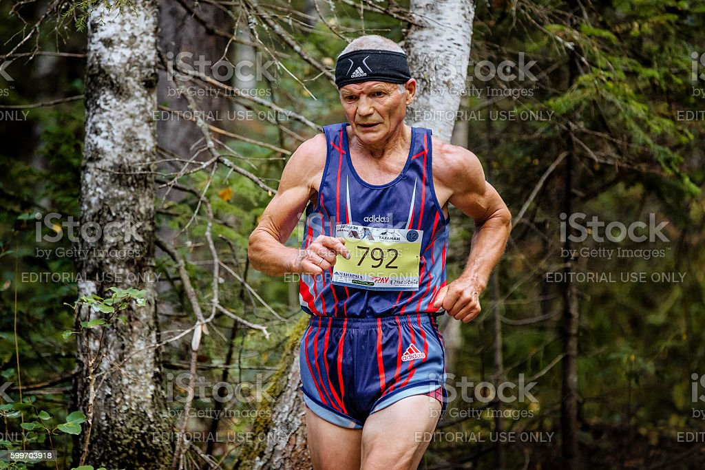 old healthy male athlete running in woods royalty-free 스톡 사진