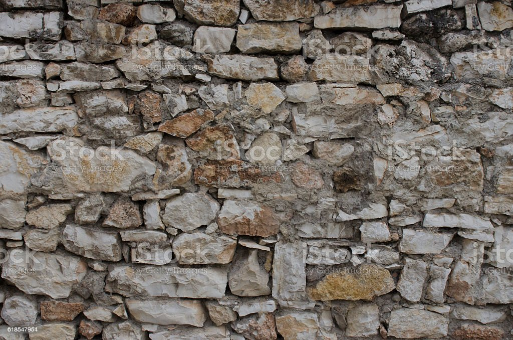 Old heaped stone wall stock photo