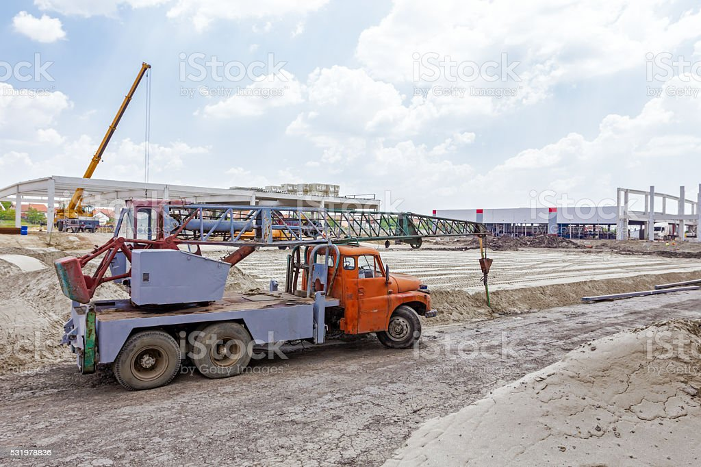 Old heavy truck mobile crane stock photo