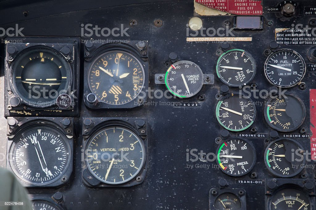 old helicopter cockpit instrument panel in flight stock photo