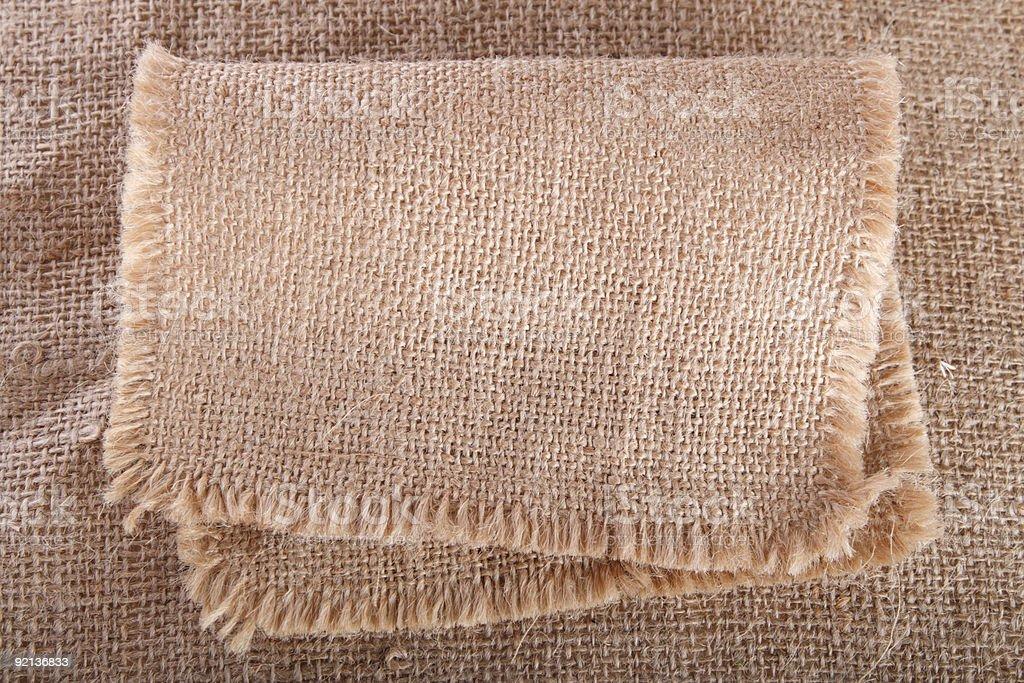 old hessian cloth folded on same background royalty-free stock photo