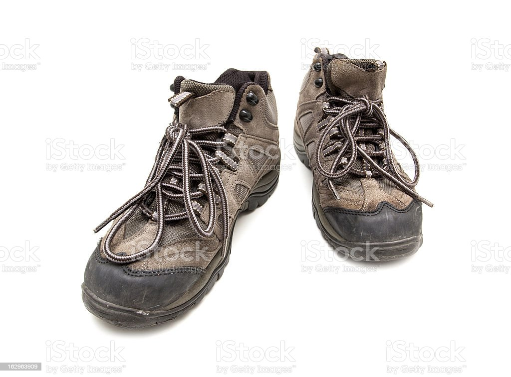 Old hiking boots isolated on white background royalty-free stock photo