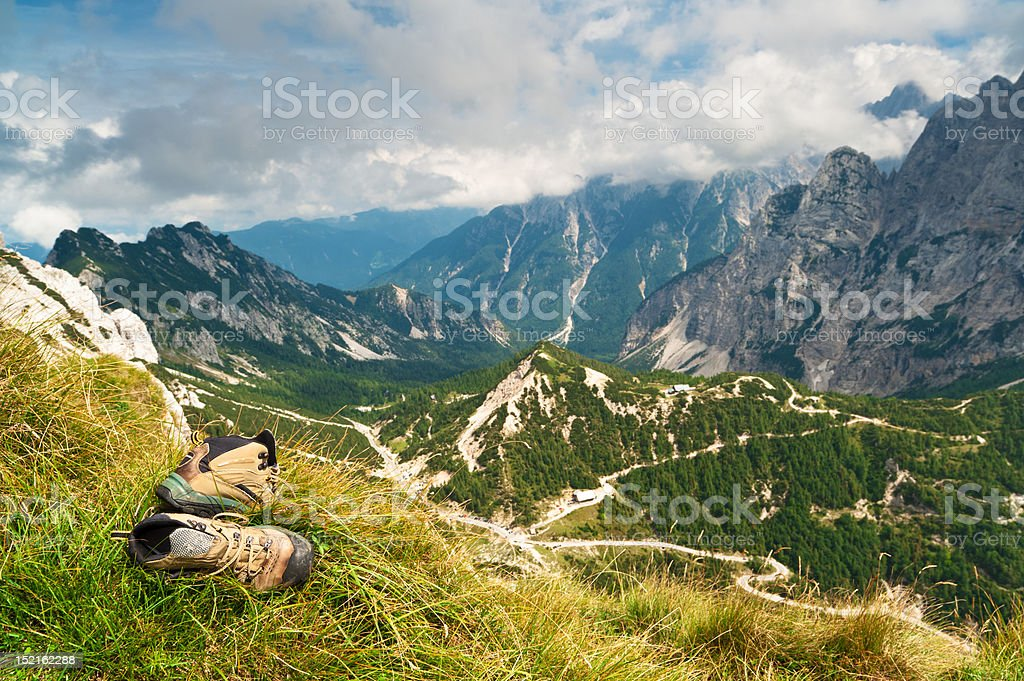 Old hiking boots on mountains background royalty-free stock photo