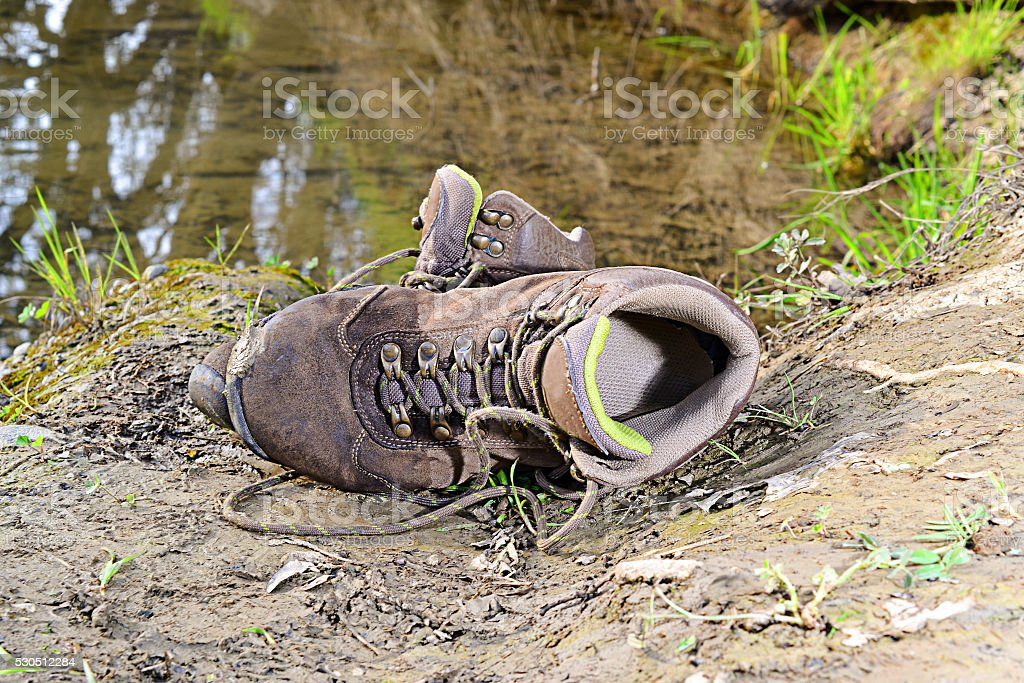 Old hiking shoes stock photo