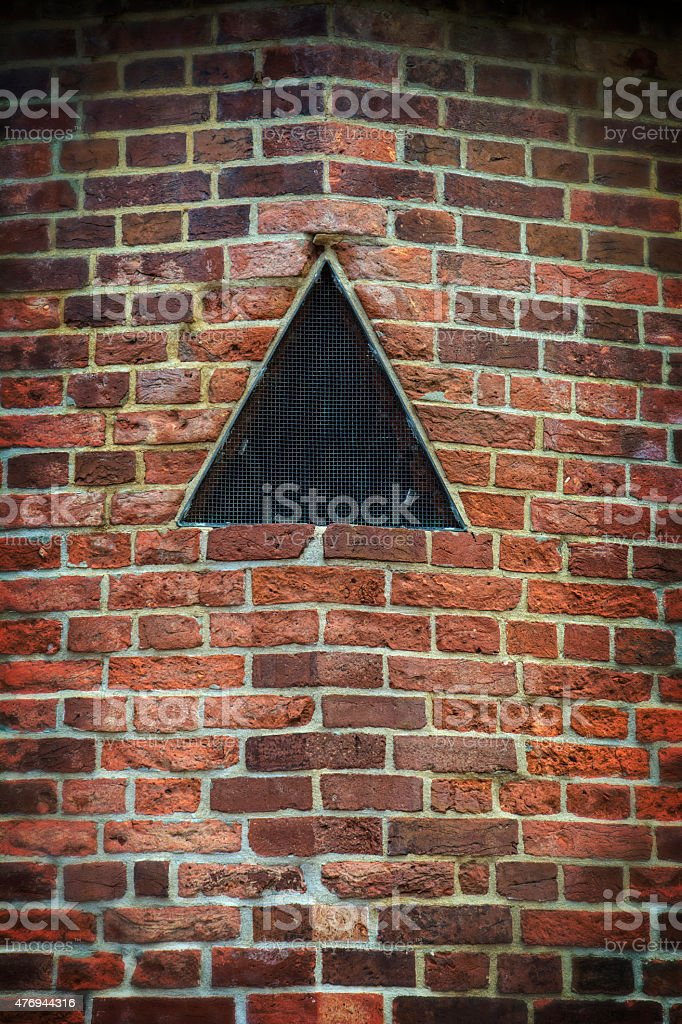 Old Historic Civil War Brick Wall With Black Triangle stock photo
