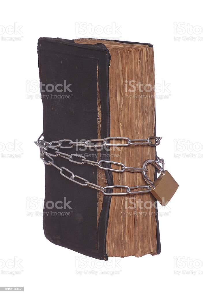 old historic prayer book protected with padlock and chain royalty-free stock photo