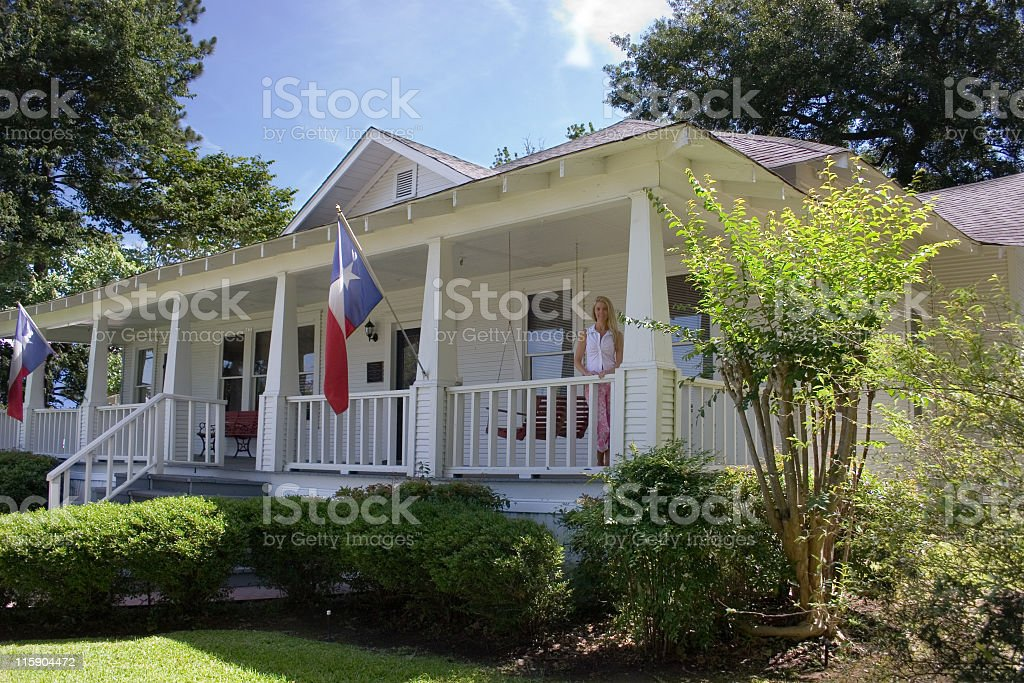 Old historical home in southern USA. Front porch. Woman. Texas. stock photo