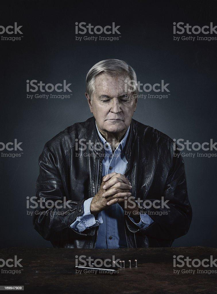 old hit-man praying stock photo