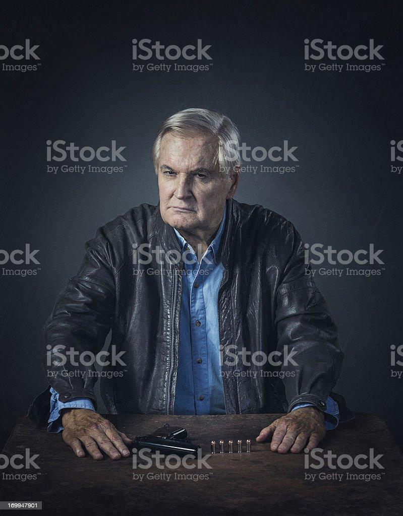 old hit-man thinking stock photo