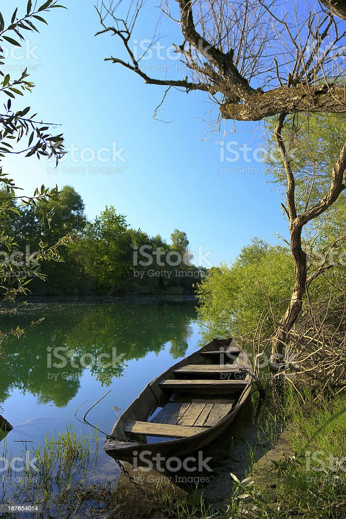 Old holey boat on the river royalty-free stock photo