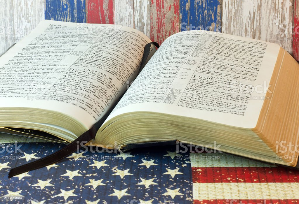 Old Holy Bible and the American Flag stock photo
