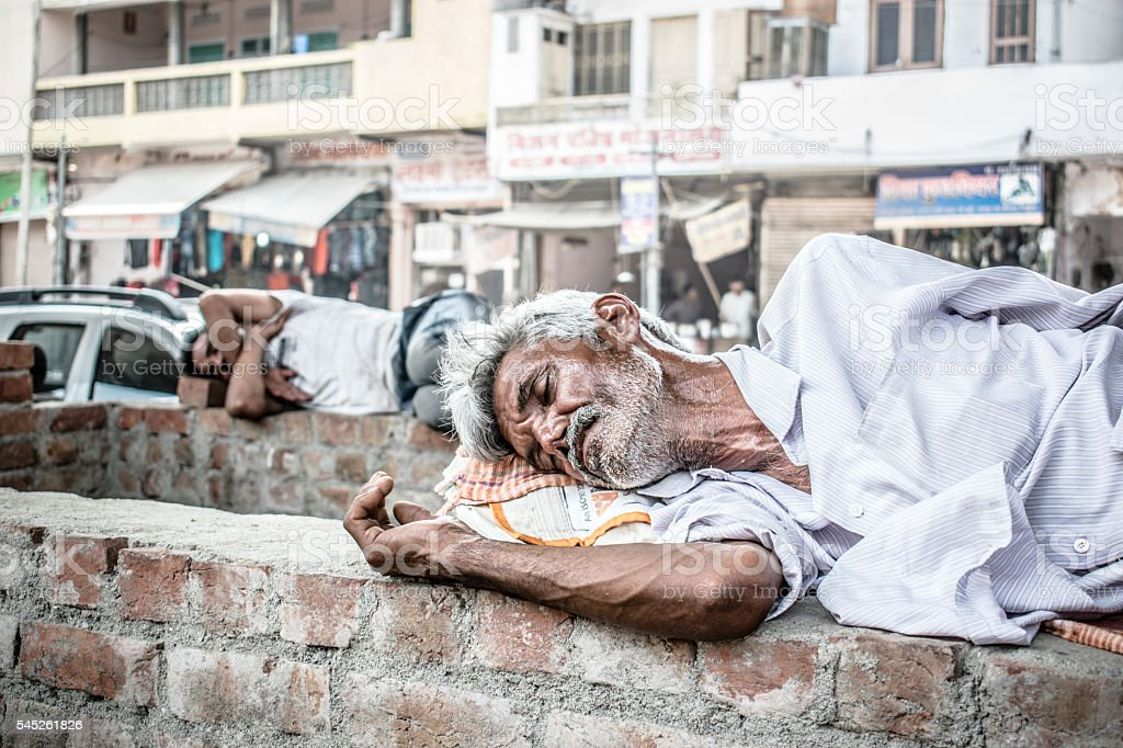 Old Homeless man India. stock photo