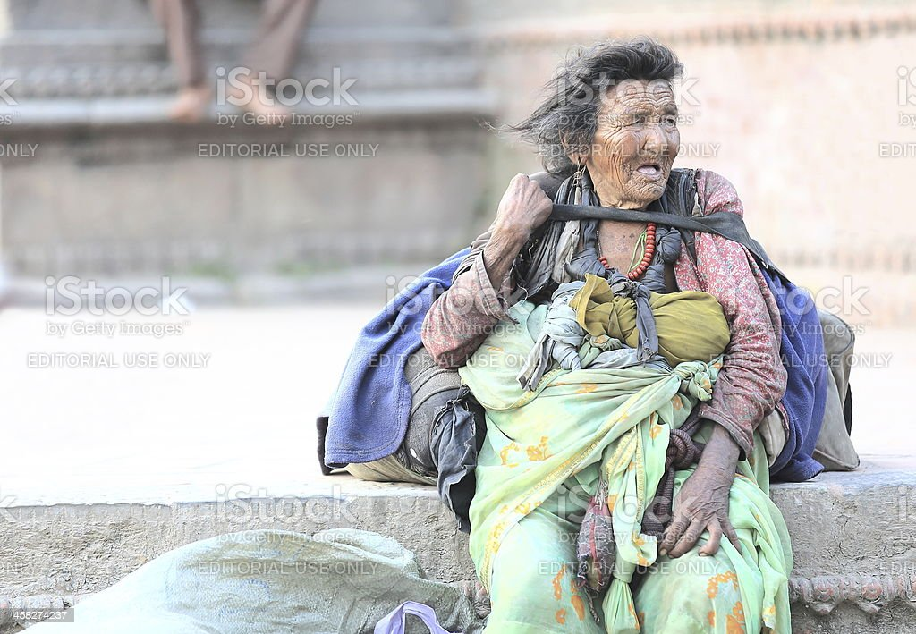 Old homeless woman. Durbar Square-Kathmandu. royalty-free stock photo