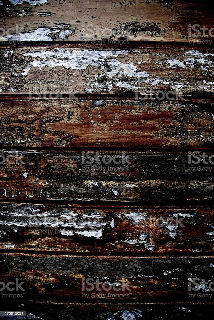Old horizontal wooden planks with peeling paint royalty-free stock photo
