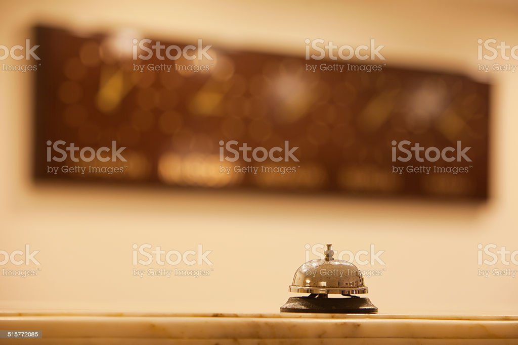 old hotel bell on a marble stand stock photo