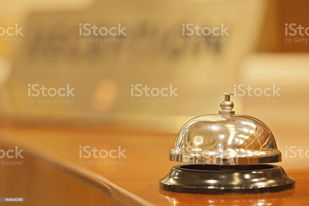old hotel bell on a wood stand stock photo