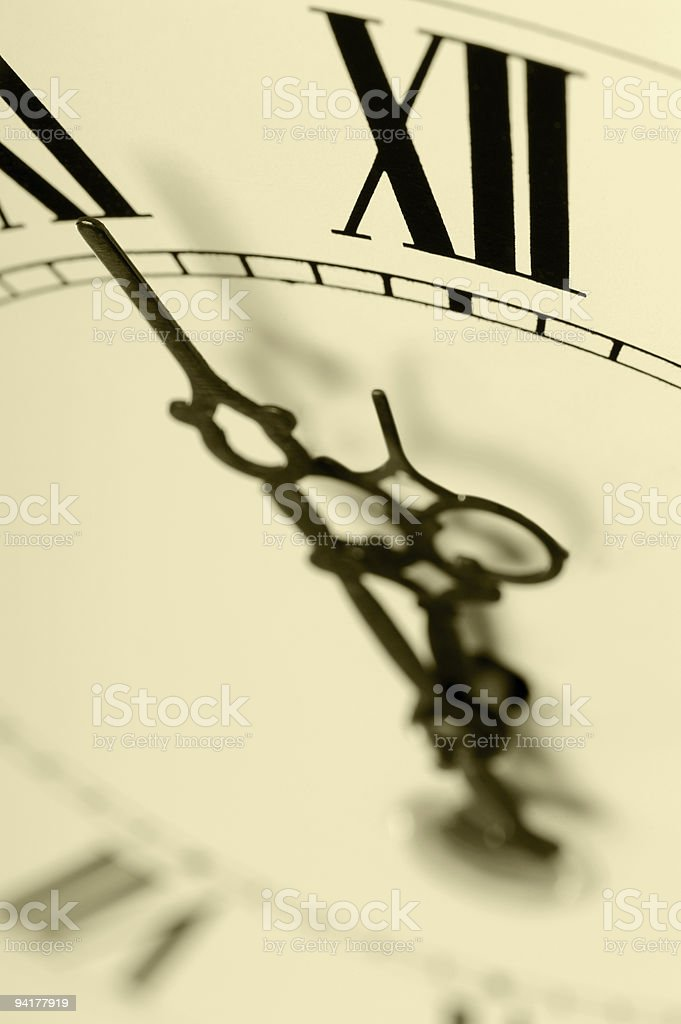 Old hours with figured arrows royalty-free stock photo