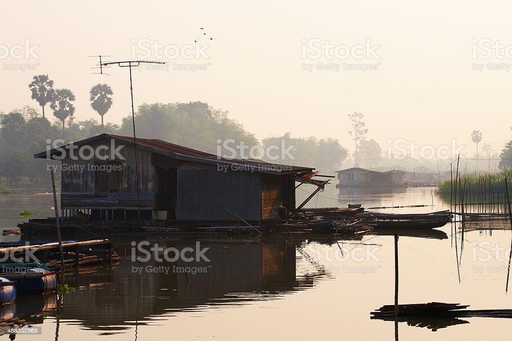 old house boat on river stock photo