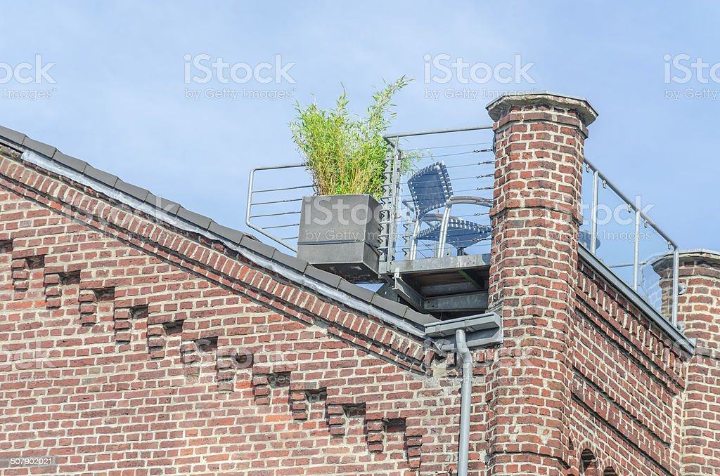 Old house facade with roof terrace stock photo