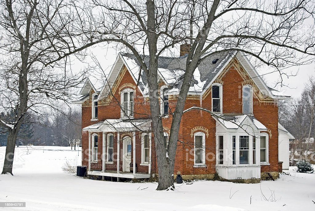 old house in winter stock photo