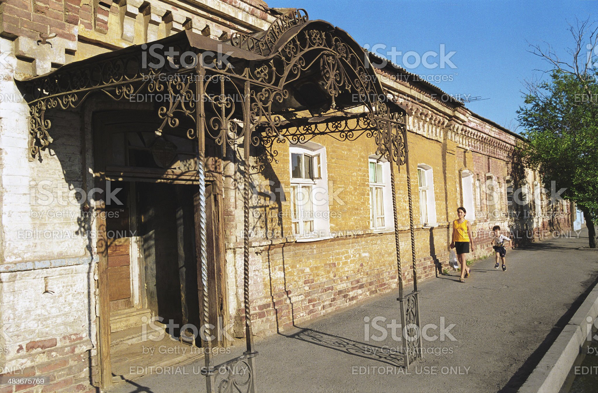 Old house of the nineteenth century with an iron canopy royalty-free stock photo