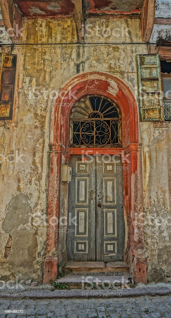 Old house ruin and door detail stock photo