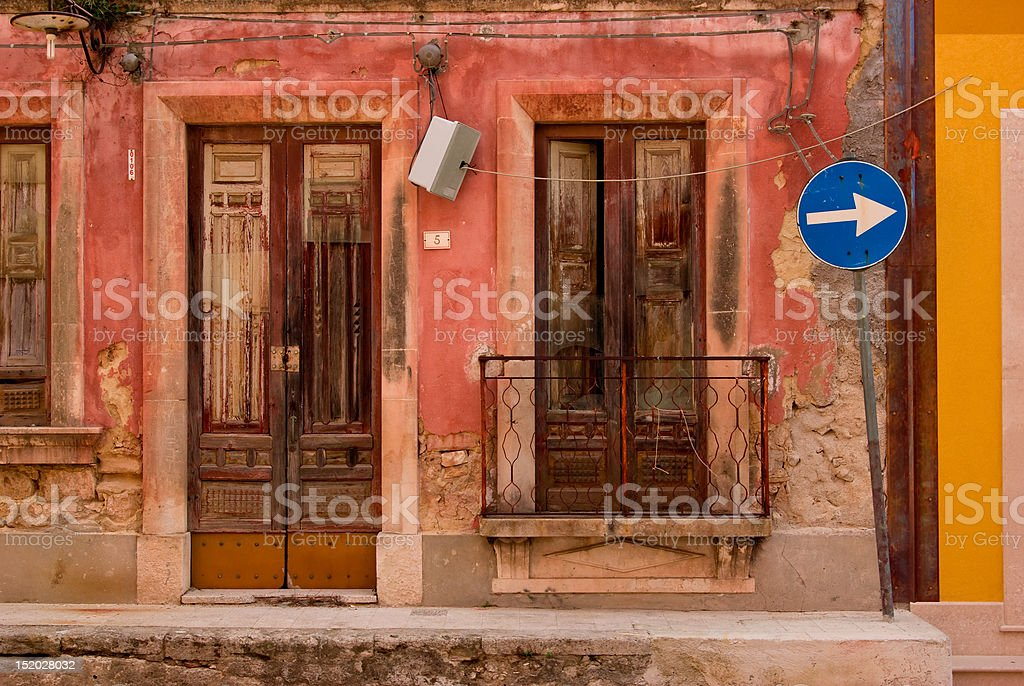 Old House wall with wooden door royalty-free stock photo